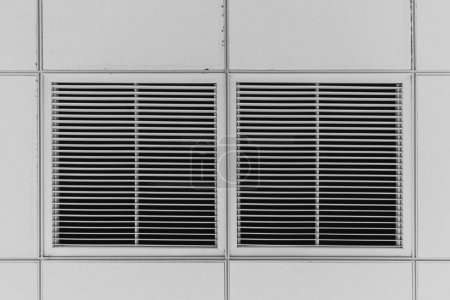 Dust out from Air Duct , Ceiling Air Grill in the office building cause of pneumonia in office man.