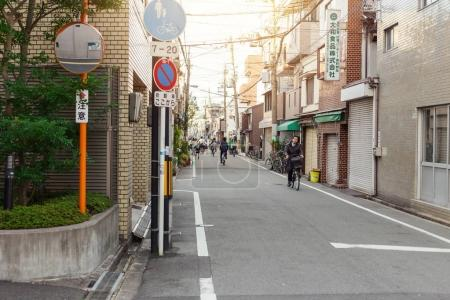 Photo for Clean japan street in the morning people are using bicycle or walking can reduce pollution in the city in Japan Osaka prefecture November 2015 - Royalty Free Image