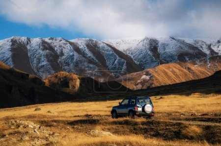 Off-road travel on car on mountain road in Caucasus, Georgia.