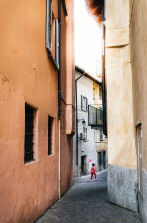 Boy in pink clothes celebrates in Chiavenna, Italy