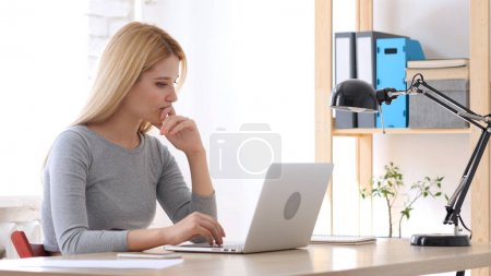 Frustrated Young Woman Working on Laptop