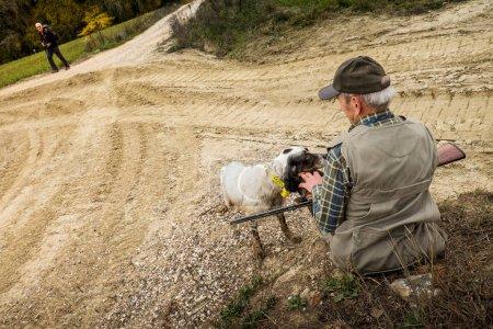 Buonconvento, Siena, Tuscany - Novembre 12, 2017: Hunter in autumn trekking in the province of Siena, from Buonconvento to Monte Oliveto Maggiore Abbey