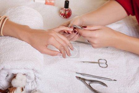 Manicurist making manicure
