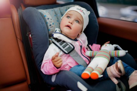 Girl sitting in child seat