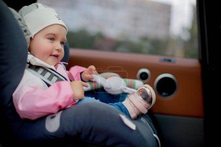 Girl sitting in child seat