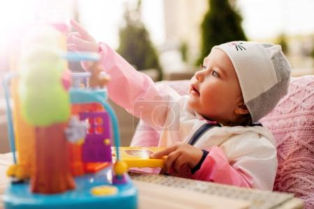 Infant girl playing with toy