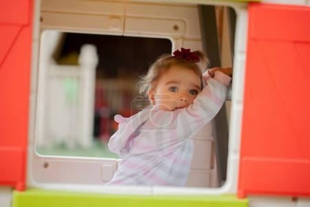 Infant girl looking in mirror