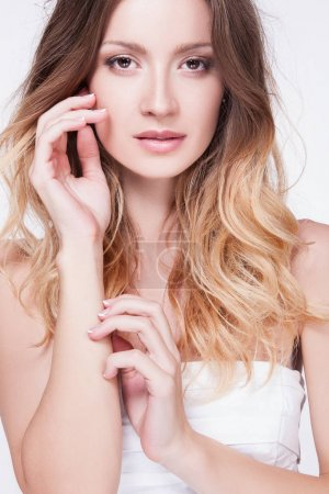 woman touching face with hand