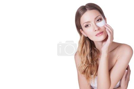 Woman using under eye mask