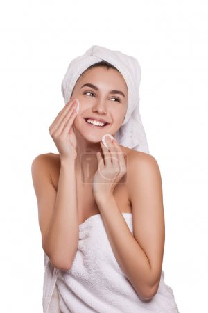 Cleansing the face skin. beautiful young woman cleans the face with cotton balls. spa. fresh healthy skin