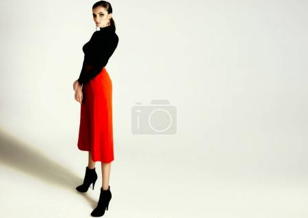 Photo for Fashion portrait of Beautiful sexy woman in black shirt and red pants - Royalty Free Image