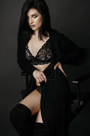 brunette woman in black clothes