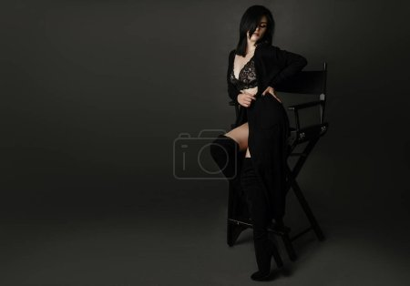 brunette woman in sophisticated clothes