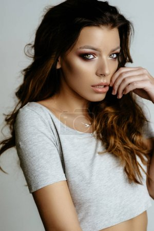 Photo for Portrait of beautiful brunette girl posing in studio on white background - Royalty Free Image