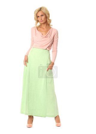 Bright positive studio portrait of woman in maxi skirt