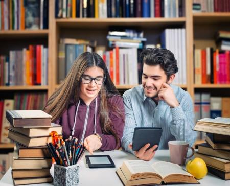 students reading ebooks