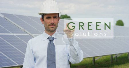 "A futuristic technical expert in solar photovoltaic panels, selects the ""Green solution"" function using pure renewable energy. The concept of remote support technology, ecology and remote control"