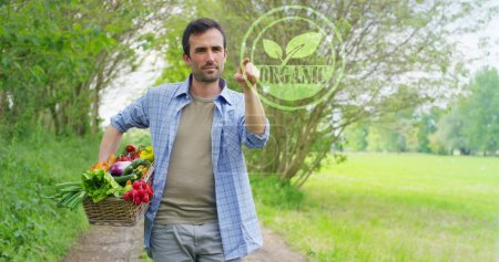 Futuristic portrait of a young man making a choice Organic, holding fresh vegetables in a basket. Concept: biological, bio-products, bio-ecology, grown by own hands, vegetarians, healthy salads