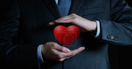 heart growing in the hands of an experienced seller or bank or insurance broker. concept for investment and passive income for retirement and annuities also health insurance concept or bank