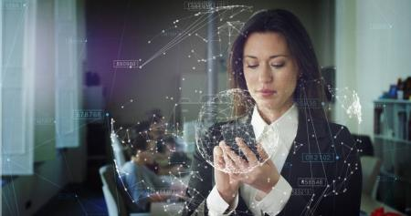 The future connection of people through a hologram,communication and sending of important files,the business lady in the office,holds the phone,trading and selling (shares).Concept:future technologies