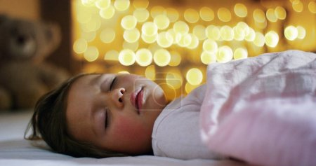 happy little girl, at Christmas, in the new year festivities asleep wait a gift for the Christmas holiday. christmas in family and children happy and tradition for the Christmas holiday and New Year.