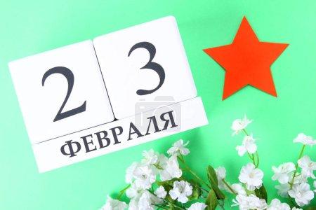 Calendrier blanc avec texte russe : 23 février. Les vacances sont le jour du défenseur de la patrie .