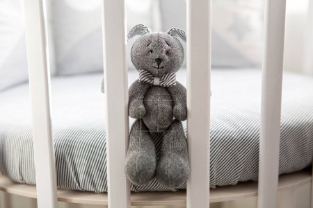 Childrens round white bed with sitting toy rabbit...