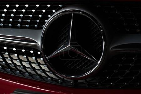 BANGKOK, THAILAND  AUGUST, 30 2017: Closeup of Mercedes Benz logo on red Mercedes Benz CLA 250 2017 model