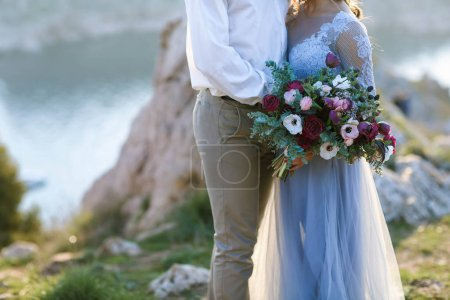bride and groom posing on outdoor wedding photosession