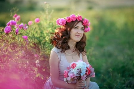Beautiful bride woman posing outdoors on the field...