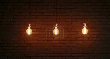 Photo for Three Edison lamps against a structured brick wall. - Royalty Free Image