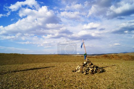 Photo for Steppe landscape  near the border with Mongolia with the stones mountain, blue flag, cloudy sky. Altai mountains, Siberia, Russia - Royalty Free Image
