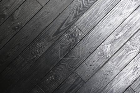 Photo for Black laminate, modern floor coating, interesting design, concept for design and decoration, common floor covering, close up - Royalty Free Image