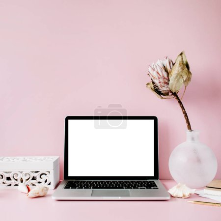 Photo for Laptop with blank screen on table with proteus flower and decoration - Royalty Free Image