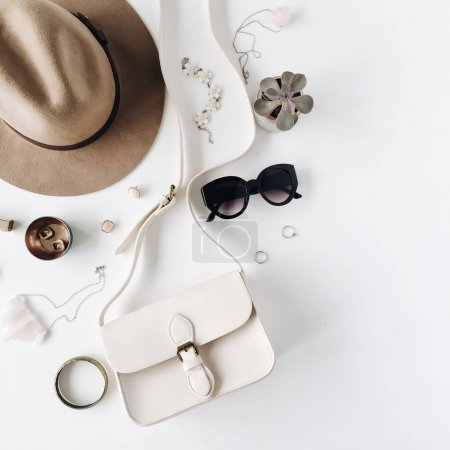 Photo for Flat lay trendy creative feminine accessories arrangement. Purse, hat, sunglasses, female accessories. Top view - Royalty Free Image