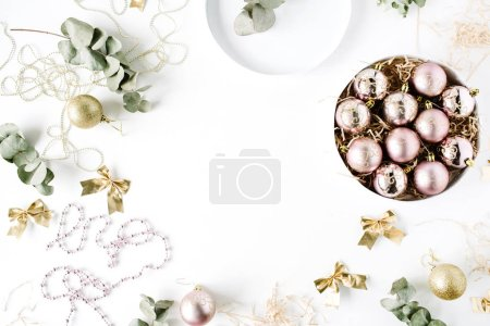 Photo for Frame made of christmas decoration with christmas glass balls, tinsel, bow, eucalyptus. christmas wallpaper. flat lay, top view - Royalty Free Image