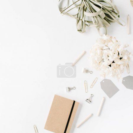 Photo for Flat lay, top view office table desk. feminine desk workspace with twine, pencils, floral bouquet, craft diary and clips on white background. - Royalty Free Image