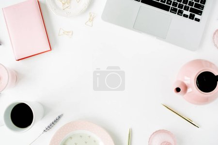 Photo for Flat lay fashion feminine home office workspace. Laptop, pink teapot, diary, coffee, golden pen and clips. Top view - Royalty Free Image