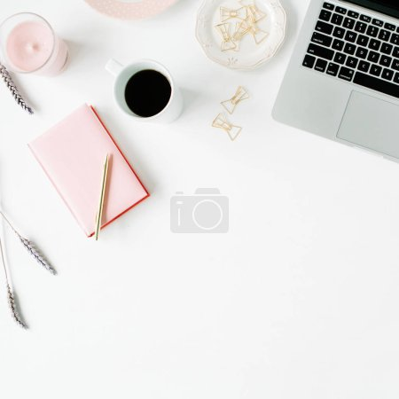 Photo for Flat lay fashion feminine home office workspace. Laptop, pink teapot, diary, golden pen and clips. Top view - Royalty Free Image