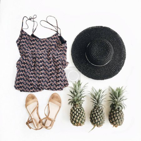 Photo for Stylish, trendy feminine clothes, accessories and pineapples. Flat lay, top view - Royalty Free Image