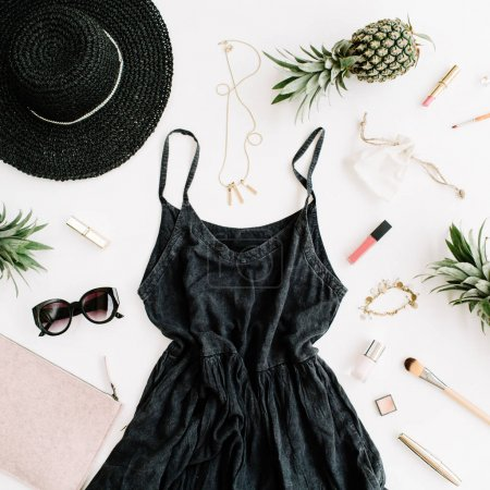 Photo for Summer casual style. Modern woman clothes and accessories collage. Dress, sunglasses, hat, purse, lipstick and pineapples. Flat lay, top view - Royalty Free Image