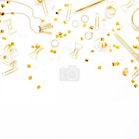 Photo for Beauty blog background. Gold style feminine accessories. Golden tinsel, scissors, pen, rings, necklace, bracelet on white background. Flat lay, top view. - Royalty Free Image
