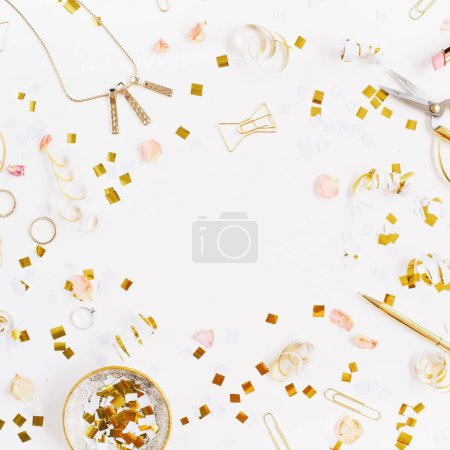 Photo for Beauty blog background. Gold style feminine accessories frame. Golden tinsel, scissors, pen, rings, necklace, bracelet on white background. Flat lay, top view. - Royalty Free Image