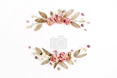 Wreath pattern with roses, pink flower buds, branches and dried leaves