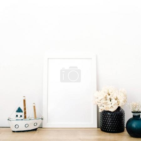 Photo for Front view blank mock up of photo frame with trendy stuff at white background. Minimalistic decorated home office concept. - Royalty Free Image