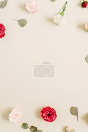 Flowers frame made of beige and red roses