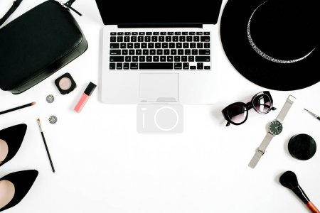 Fashion blogger office desk with laptop