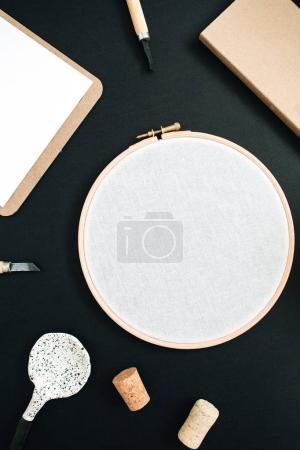 Embroidery frame, clipboard, handmade spoon, cone