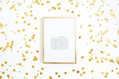 Photo frame with golden confetti tinsel