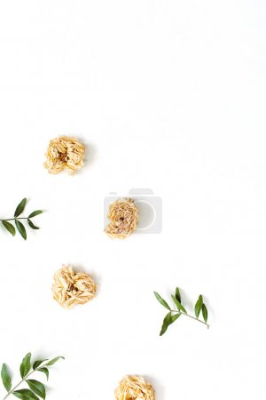 Photo for Floral border frame made of dry pastel beige roses on white background. Flat lay, top view. Floral texture background. - Royalty Free Image